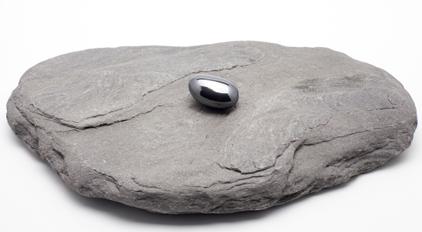 Black Hematite Pebble on a stone